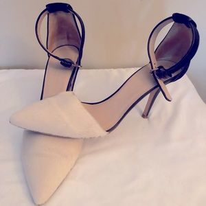 Beautiful black and white pony hair pumps